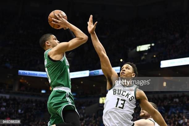 Jayson Tatum of the Boston Celtics is defended by Malcolm Brogdon of the Milwaukee Bucks during the first half of game three of round one of the...