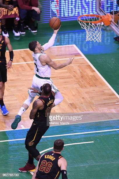 Jayson Tatum of the Boston Celtics lays up a shot against LeBron James of the Cleveland Cavaliers during Game Five of the 2018 NBA Eastern Conference...
