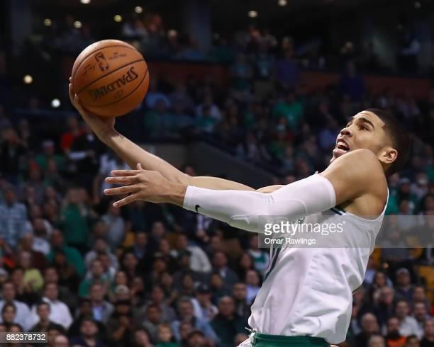 Jayson Tatum of the Boston Celtics lays up during the game against the Detroit Pistons at TD Garden on November 27 2017 in Boston Massachusetts NOTE...