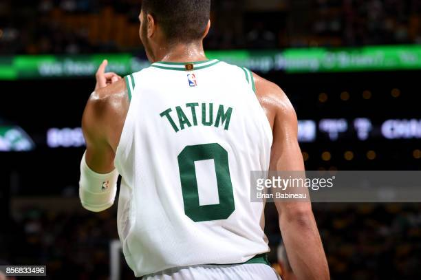 Jayson Tatum of the Boston Celtics looks on during the game against the Charlotte Hornets during a preseason game on October 2 2017 at the TD Garden...