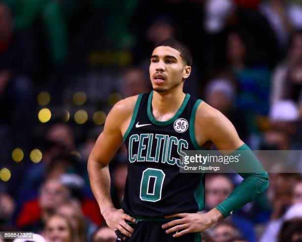 Jayson Tatum of the Boston Celtics looks on during the game against the Chicago Bulls at TD Garden on December 23 2017 in Boston Massachusetts NOTE...
