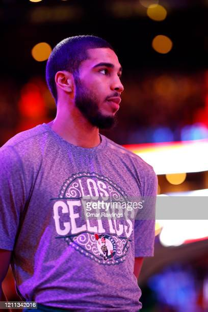 Jayson Tatum of the Boston Celtics looks on during the National Anthem before the game against the Oklahoma City Thunder at TD Garden on March 08...