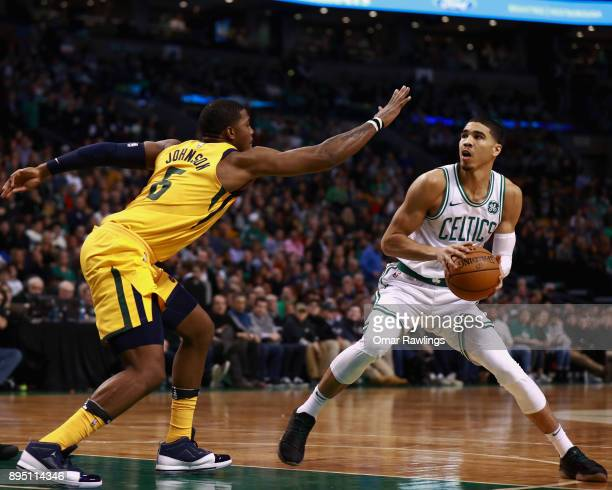 Jayson Tatum of the Boston Celtics looks to shoot while guarded by Joe Johnson of the Utah Jazz during the game at TD Garden on December 15 2017 in...