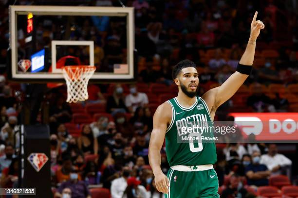 Jayson Tatum of the Boston Celtics reacts against the Miami Heat during the second half of a preseason game at FTX Arena on October 15, 2021 in...