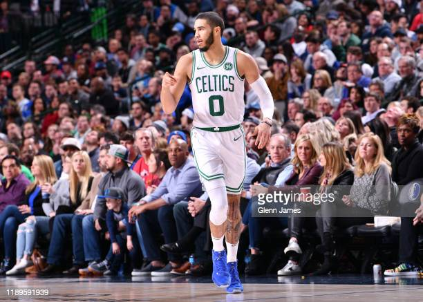 Jayson Tatum of the Boston Celtics reacts to a play against the Dallas Mavericks on December 18 2019 at the American Airlines Center in Dallas Texas...