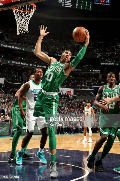 Jayson Tatum of the Boston Celtics rebounds the ball during the game against the Charlotte Hornets on December 27 2017 at Spectrum Center in...
