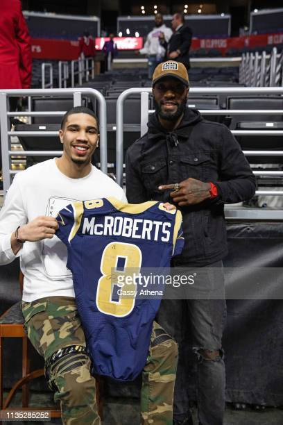 Jayson Tatum of the Boston Celtics receives a Rams jersey from childhood friend Paul McRoberts after their game against the Los Angeles Clippers at...