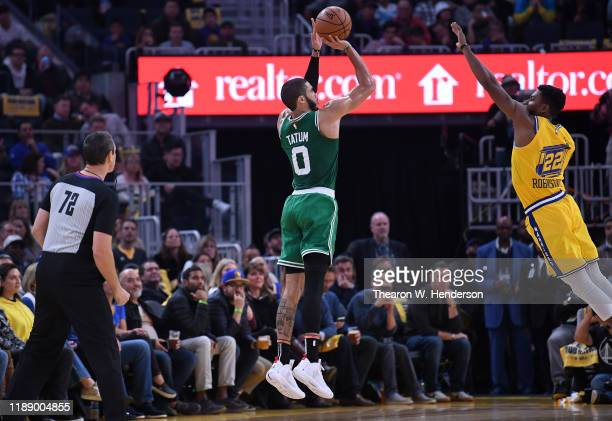 Jayson Tatum of the Boston Celtics shoots over Glenn Robinson III of the Golden State Warriors during the first half of an NBA basketball game at...