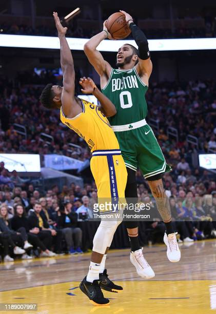 Jayson Tatum of the Boston Celtics shoots over Glenn Robinson III of the Golden State Warriors during the second half of an NBA basketball game at...