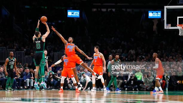 Jayson Tatum of the Boston Celtics shoots over Terrance Ferguson of the Oklahoma City Thunder during the first quarter of the game at TD Garden on...
