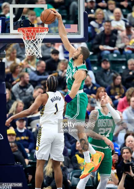 Jayson Tatum of the Boston Celtics shoots the ball against the Indiana Pacers at Bankers Life Fieldhouse on March 10 2020 in Indianapolis Indiana...