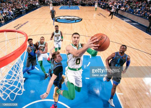 Jayson Tatum of the Boston Celtics shoots the ball against the Dallas Mavericks on November 24 2018 at the American Airlines Center in Dallas Texas...