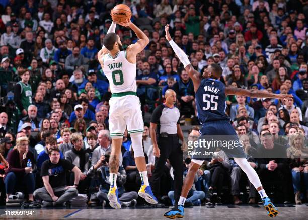 Jayson Tatum of the Boston Celtics shoots the ball against the Dallas Mavericks on December 18 2019 at the American Airlines Center in Dallas Texas...