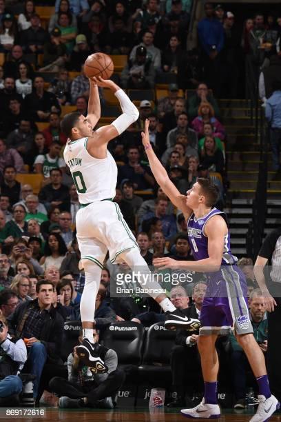 Jayson Tatum of the Boston Celtics shoots the ball against the Sacramento Kings on November 1 2017 at the TD Garden in Boston Massachusetts NOTE TO...