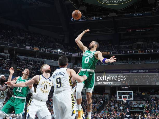 Jayson Tatum of the Boston Celtics shoots the ball against the Indiana Pacers on March 10 2020 at Bankers Life Fieldhouse in Indianapolis Indiana...