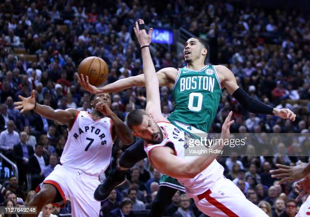 Jayson Tatum of the Boston Celtics shoots the ball as Marc Gasol and Kyle Lowry of the Toronto Raptors defend during the first half of an NBA game at...