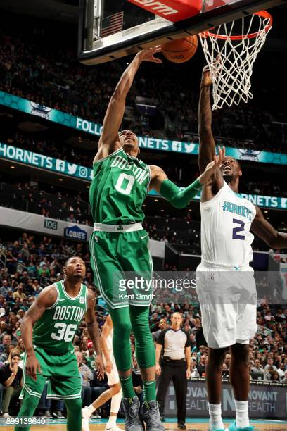 Jayson Tatum of the Boston Celtics shoots the ball during the game against the Charlotte Hornets on December 27 2017 at Spectrum Center in Charlotte...