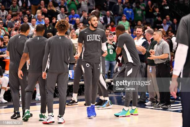 Jayson Tatum of the Boston Celtics smiles before the game against the Dallas Mavericks on December 18 2019 at the American Airlines Center in Dallas...