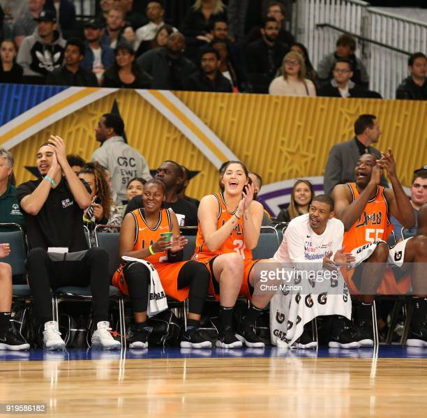 Jayson Tatum of the Boston Celtics Stefanie Dolson of the Chicago Sky and former NBA player Dikembe Mutombo cheer during the 2018 NBA Cares Unified...