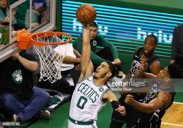 Jayson Tatum of the Boston Celtics takes a shot against Giannis Antetokounmpo of the Milwaukee Bucks during the first quarter of Game One of Round...