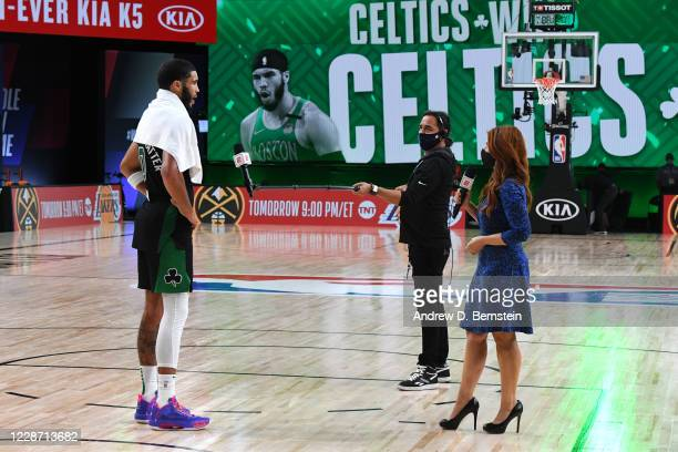 Jayson Tatum of the Boston Celtics talks with reporter Rachel Nichols after winning Game Five of the Eastern Conference Finals of the NBA Playoffs on...