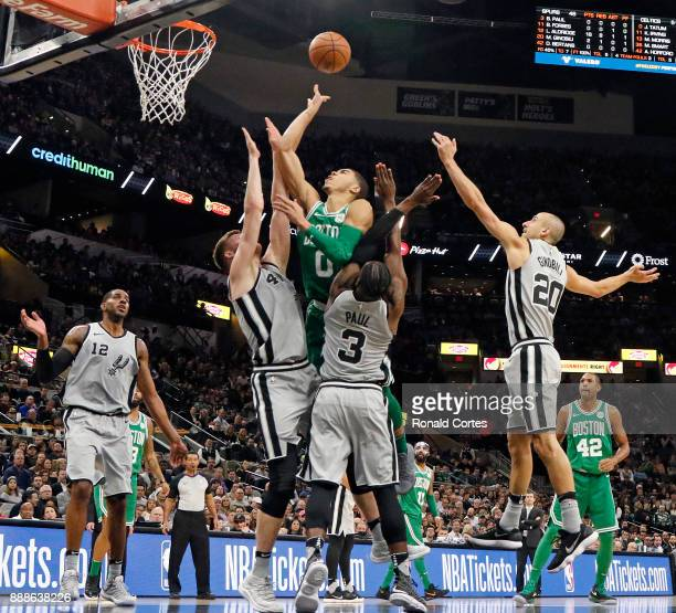 Jayson Tatum of the Boston Celtics tries to shoot over Davis Bertans of the San Antonio Spurs and Brandon Paul of the San Antonio Spurs at ATT Center...
