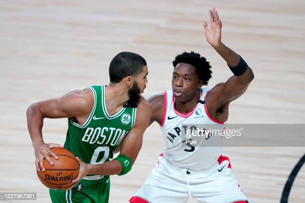 Jayson Tatum of the Boston Celtics works against OG Anunoby of the Toronto Raptors during the second half of an NBA basketball game at the ESPN Wide...