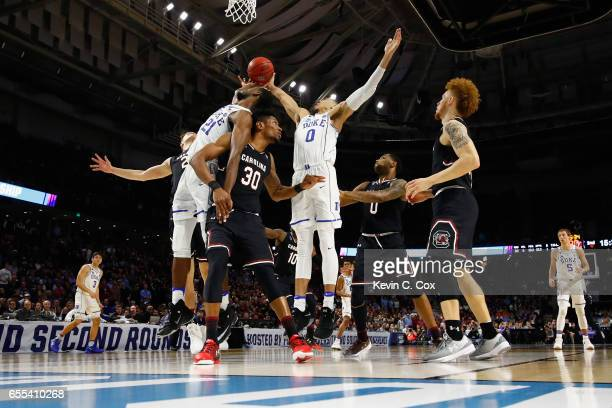Jayson Tatum of the Duke Blue Devils battles for a rebonud in the second half against the South Carolina Gamecocks during the second round of the...