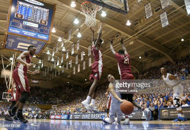 Jayson Tatum of the Duke Blue Devils collides with teammates Jonathan Isaac and Christ Koumadje of the Florida State Seminoles during their game at...