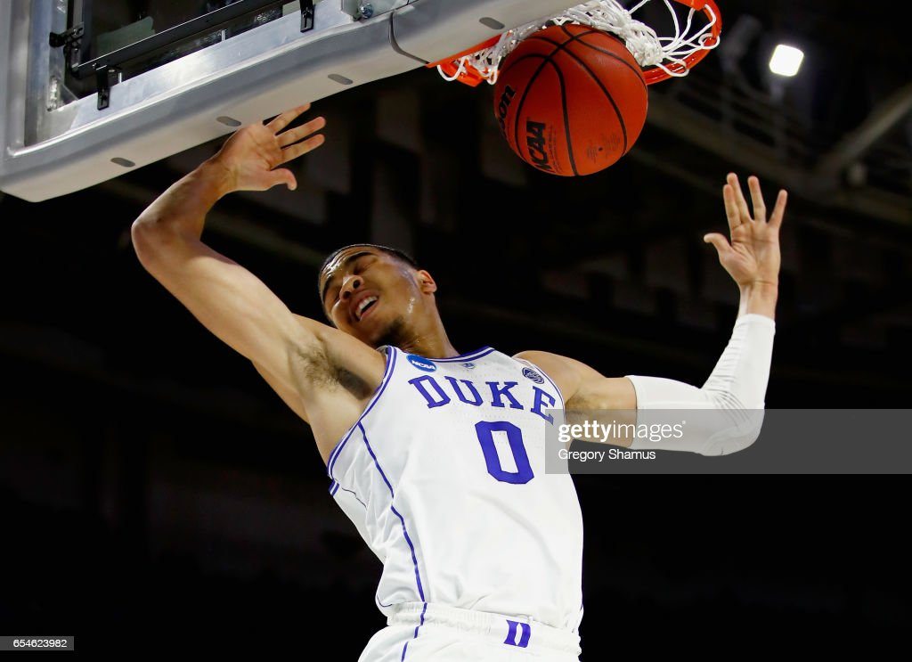 Jayson Tatum #0 of the Duke Blue Devils dunks against the Troy Trojans in the first half during the first round of the 2017 NCAA Men's Basketball Tournament at Bon Secours Wellness Arena on March 17, 2017 in Greenville, South Carolina.