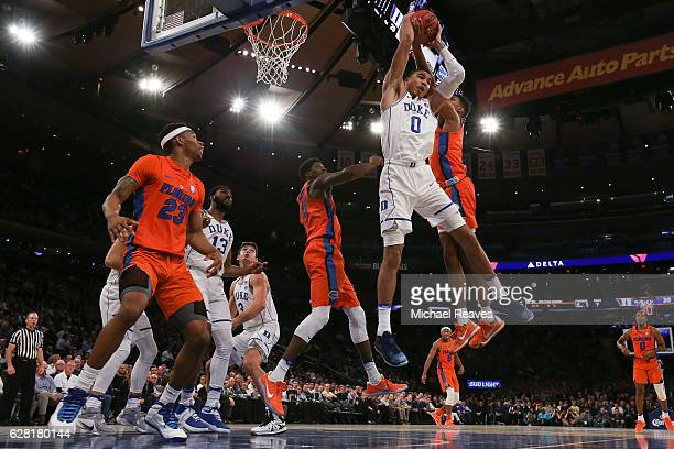Jayson Tatum of the Duke Blue Devils fights for a rebound with Devin Robinson of the Florida Gators in the first half during the Jimmy V Classic at...