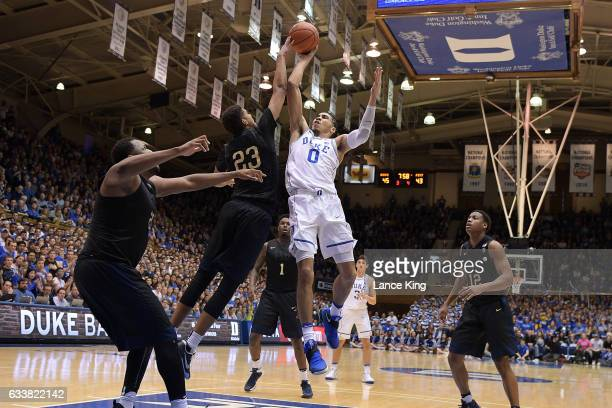Jayson Tatum of the Duke Blue Devils puts up a shot against Cameron Johnson of the Pittsburgh Panthers at Cameron Indoor Stadium on February 4 2017...