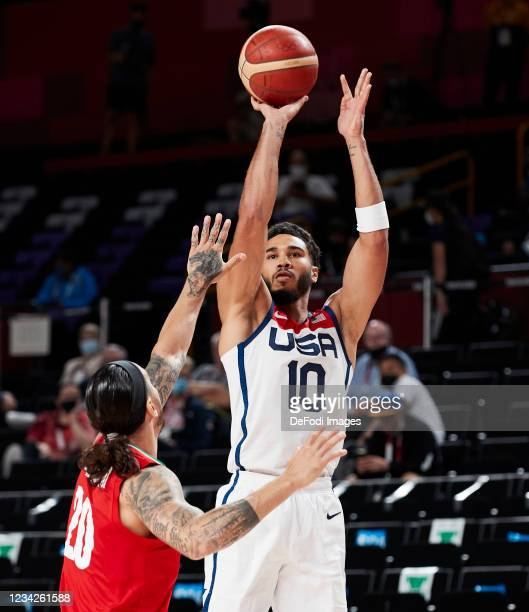 Jayson Tatum of USA and Michael Rostampour of Iran battle for the ball during the Basketball Preliminary Round Group A Match between United States...