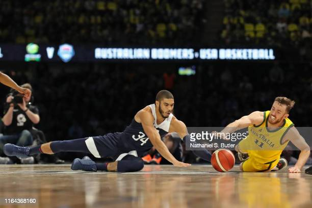 Jayson Tatum of USA fights for the ball against Nick Kay of the Australia Boomers on August 24 2019 at Marvel Stadium in Melbourne Australia NOTE TO...
