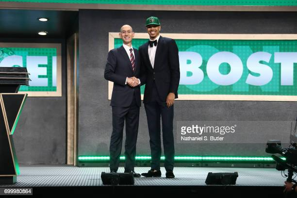 Jayson Tatum shakes hands with NBA Commissioner Adam Silver after being selected number three overall by the Boston Celtics during the 2017 NBA Draft...
