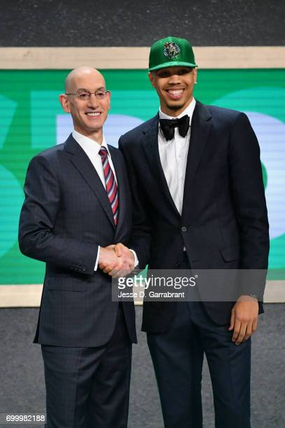 Jayson Tatum the third overall pick selected by the Boston Celtics smiles with Adam Silver during the 2017 NBA Draft on June 22 2017 at Barclays...