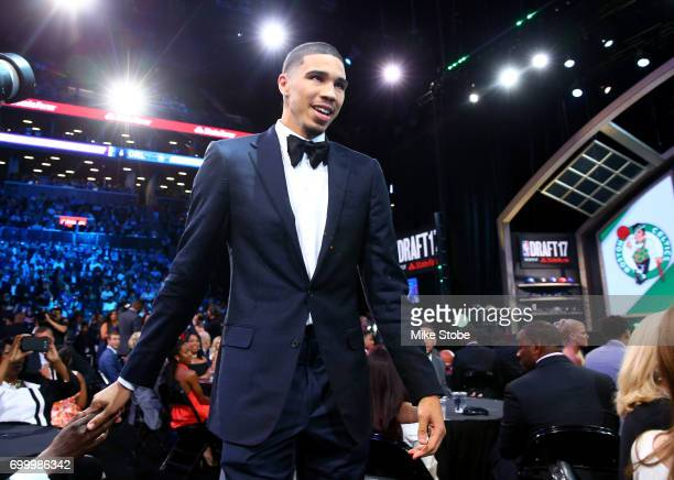 Jayson Tatum walks to stage after being drafted third overall by the Boston Celtics during the first round of the 2017 NBA Draft at Barclays Center...