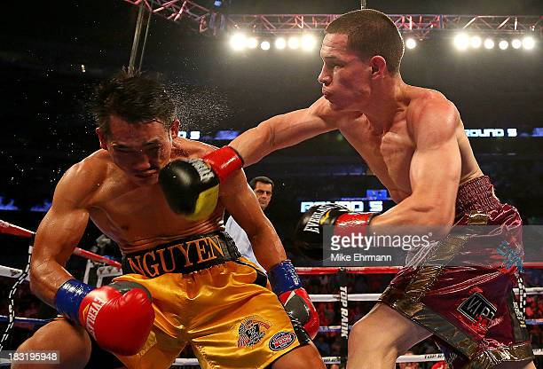 Jayson Velez of Puerto Rico lands a punch against Dat Nguyen during a Featherweight bout at Amway Center on October 5 2013 in Orlando Florida