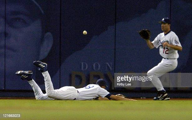 Jayson Werth of the Los Angeles Dodgers makes an unsuccesful diving attempt to catch a fly ball as Steve Finley looks on during 64 loss to the...