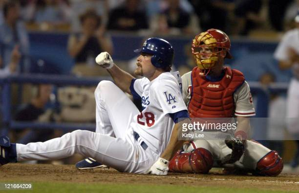 Jayson Werth of the Los Angeles Dodgers slides beneath tag of Philadelphia Phillies catcher Mike Lieberthal to score on a double by Hee-Seop Choi in...
