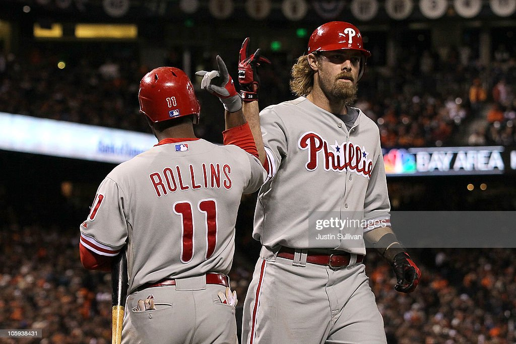 Jayson Werth #28 of the Philadelphia Phillies celebrates a solo homerun against the San Francisco Giants with teammate Jimmy Rollins #11 in the ninth inning of Game Five of the NLCS during the 2010 MLB Playoffs at AT&T Park on October 21, 2010 in San Francisco, California.