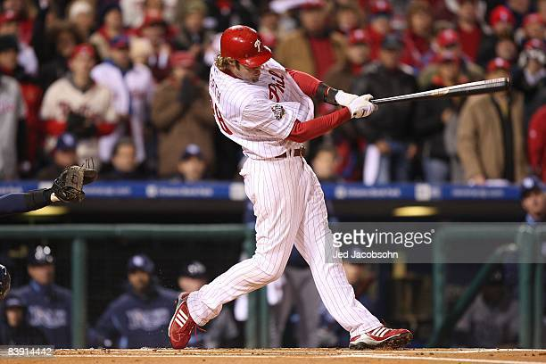 Jayson Werth of the Philadelphia Phillies hits a RBI single to score Geoff Jenkins in the bottom of the sixth inning against the Tampa Bay Rays...