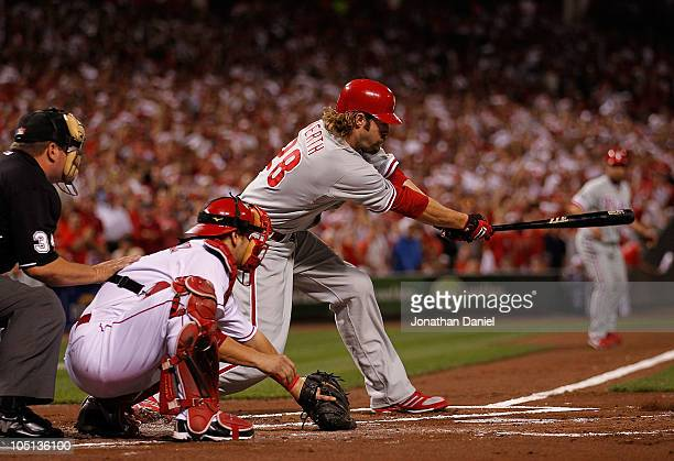 Jayson Werth of the Philadelphia Phillies hits a runscoring single in the 1st inning against the Cincinnati Reds during game 3 of the NLDS at Great...