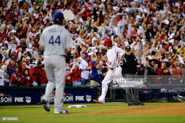 Jayson Werth of the Philadelphia Phillies rounds the bases after hitting a first inning home run off of Vicente Padilla of the Los Angeles Dodgers in...