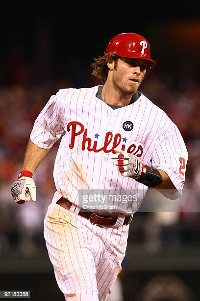 Jayson Werth of the Philadelphia Phillies rounds the bases after his seventh inning home run against the Los Angeles Dodgers in Game Five of the NLCS...