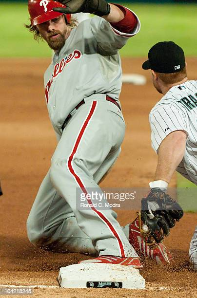 Jayson Werth of the Philadelphia Phillies slides into third base during a MLB game against the Florida Marlins at Sun Life Stadium on September 15...