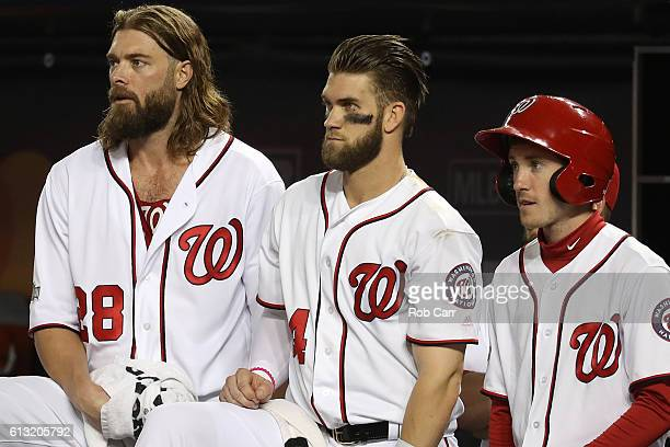Jayson Werth of the Washington Nationals and teammate Bryce Harper look on in the third inning against the Los Angeles Dodgers in game one of the...