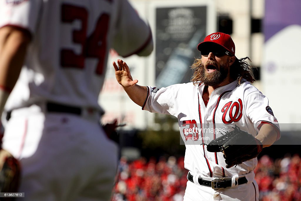 Jayson Werth #28 of the Washington Nationals celebrates after making a catch for the third out of the fifth inning with bases loaded against the Los Angeles Dodgers during game two of the National League Division Series at Nationals Park on October 9, 2016 in Washington, DC.