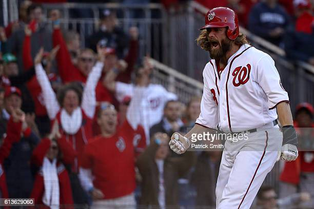 Jayson Werth of the Washington Nationals celebrates after scoring off of an RBI single hit by Daniel Murphy in the seventh inning against the Los...
