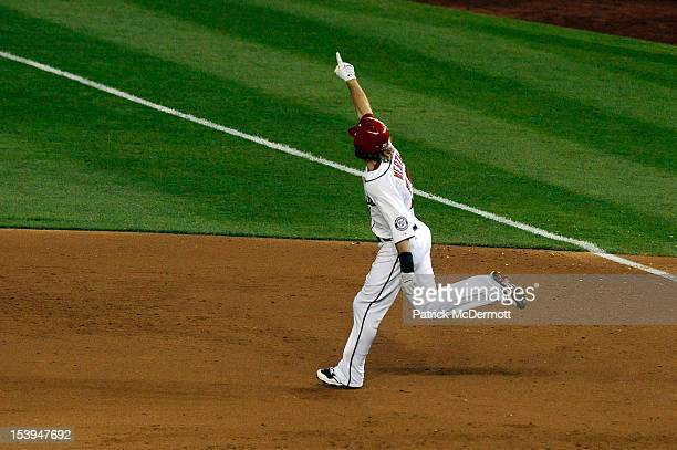 Jayson Werth of the Washington Nationals celebrates as he rounds first base on his solo gamewinning walkoff home run in the bottom of the ninth...